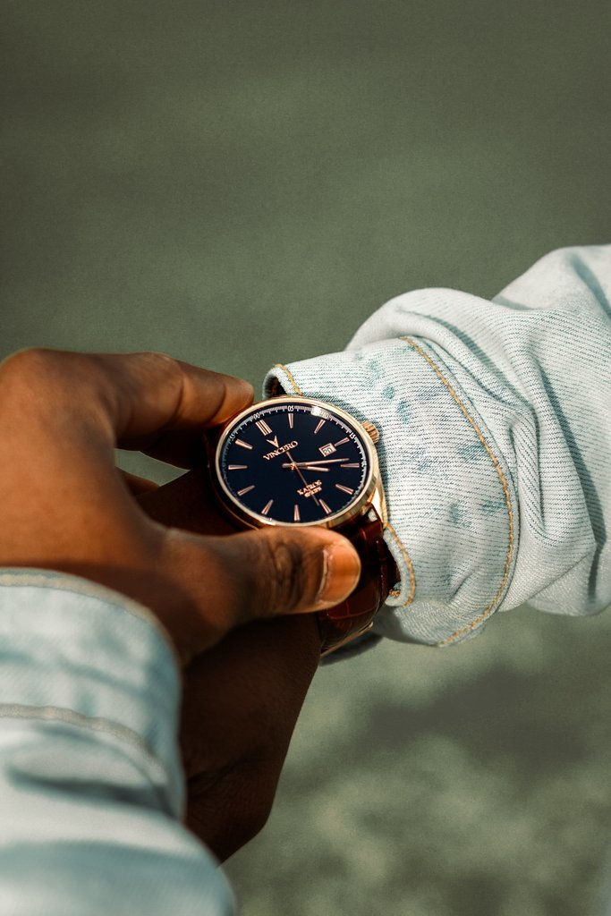 person-holding-analog-watch-3130646